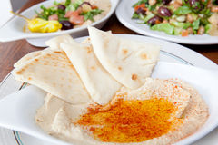 Variety of Mediteranean style dishes like hummus and salad Royalty Free Stock Photos