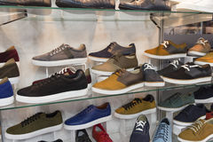 Variety of men`s shoes in the shop window Royalty Free Stock Photo