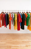 Variety of multicolored clothes on a rod Stock Photography