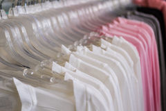 Variety of multicolored shirt clothes hangers. Stock Image