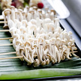 Variety of mushrooms skewerd on wooden sticks ready to grilled Royalty Free Stock Images