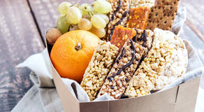 Variety muslie bar with fruit in cardboard box stock image