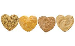 Variety of mustard in heart chape stock photos