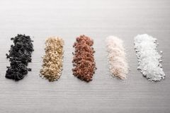 Spicy salt. Variety of natural and spicy salt on wooden table stock photos