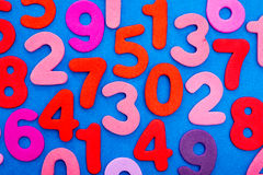 Variety of Numbers in red and pink on blue Royalty Free Stock Photo