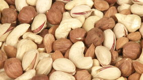 Variety of nuts close-up stock video footage