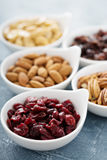 Variety of nuts and dried fruits in small bowls Stock Image