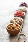 Variety of nuts and dried fruits in small bowls Royalty Free Stock Photography