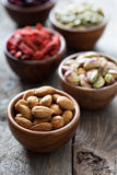 Variety of nuts and dried fruits in small bowls Stock Photo
