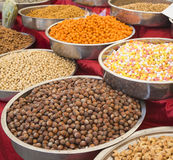 A variety of nuts in the glaze: peanuts, hazelnuts, chestnuts, walnuts, pistachio and pecans. Stock Photos