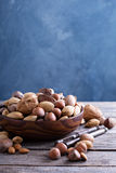 Variety of nuts with shells in a bowl Royalty Free Stock Photos