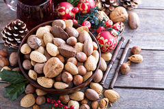 Variety of nuts with shells in a bowl Stock Images