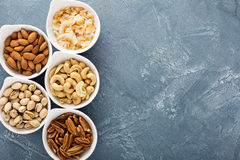 Variety of nuts in small bowls Royalty Free Stock Photos