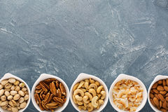 Variety of nuts in small bowls Royalty Free Stock Photography