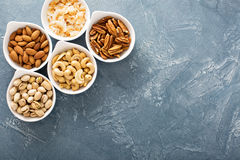 Variety of nuts in small bowls Stock Image