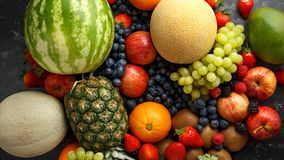 Free Variety Of Fresh Fruits And Berries On Dark Background: Cantaloupe, Melon, Watermelon, Blueberry, Oranges, Apple Royalty Free Stock Image - 146927296