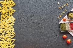 Variety Of Italian Pasta, Pesto, Herbs & Spices. Copy Space. Stock Photos
