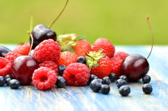 Variety Of Soft Fruits, Strawberries, Raspberries, Cherries, Blueberries On Table Royalty Free Stock Images