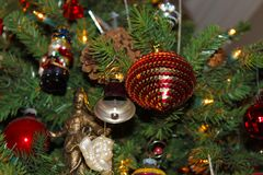 A variety of old fashioned ornaments and pine cones on a Christmas Tree stock images