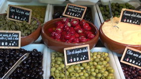 Variety of olives and other gourmet food in french market, Paris stock video footage
