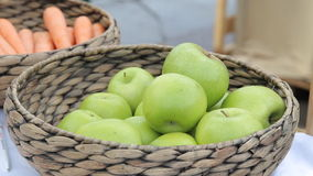 Variety of organic apples in baskets on wood table. Variety of organic apples in baskets on wood table stock video