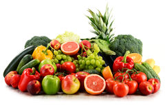 Variety of organic vegetables and fruits on white Stock Images