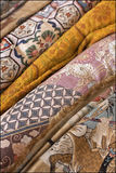 Variety of oriental fabrics. Close-up of different fabrics with traditional decoration, Panjiayuan market, Beijing, China Stock Photos