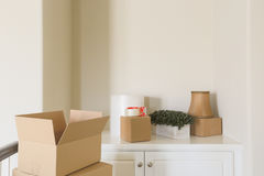 Variety of Packed Moving Boxes In Empty Room royalty free stock photo