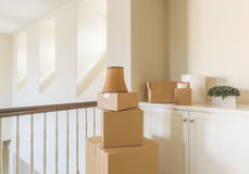 Variety of Packed Moving Boxes In Empty Room Stock Photography