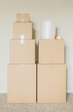 Variety of Packed Moving Boxes In Empty Room Stock Photos