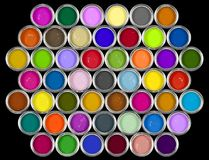 Tins of paint. A variety of paint/ink colours on a black background Royalty Free Stock Photos