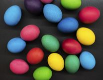 Variety of painted Easter eggs on dark background royalty free stock photo