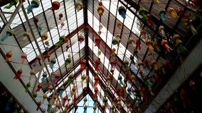 Variety paper lamps hanging on roof. Variety colorful paper lamps hanging on roof stock footage