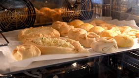 A variety of pastries baked in the oven. Kitchen stock video