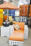 Variety of patio umbrellas and seating furniture in garden furniture store Royalty Free Stock Photo