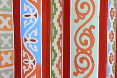 A variety of patterns. On the wall of a variety of patterns made ??of different colors and shapes Royalty Free Stock Photos
