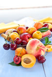 Variety of peaches and cherries Stock Images