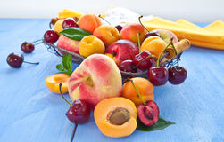 Variety of peaches and cherries Stock Photos