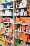 Variety of pharmaceutical products and medicine in shelves. BARCELONA, SPAIN - MARCH 02, 2016: Shelving storage system with medicine and drugs in modern farmacy Royalty Free Stock Photo