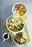 Variety of poke bowls with tuna, salmon and tofu