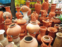 Variety of pottery. A pottery store full with various different types of pots and other decorative articles Stock Photos
