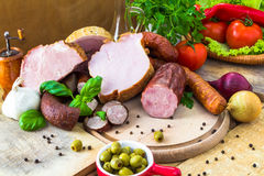 Variety processed meat products vegetables Royalty Free Stock Images