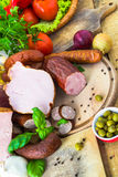 Variety processed meat products vegetables Stock Photo