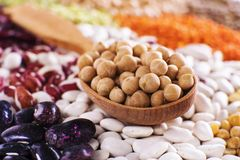 Grains seed soybeans on wooden spoon with various of legumes stock image