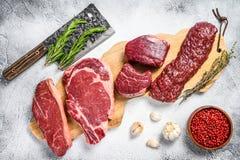 Variety of raw black angus beef meat steaks fillet Mignon, rib eye or cowboy, Striploin or new york, skirt or machete