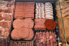 Variety Of Raw Meat - Kebabs Of Minced Meat, Beef Patties, Pork Skewers,Kebabs Wrapped In Bacon And Sausages Stock Image