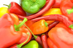 Variety of raw peppers  on white Royalty Free Stock Images