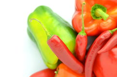 Variety of raw peppers  on white Royalty Free Stock Photo