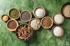 Variety of grains. Variety of raw uncooked grains superfood cereal chia linen, sesame, mung bean, walnuts, tapioca, wheat, buckwheat, oatmeal, coconut, rice in royalty free stock photography