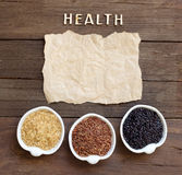 Variety of rice with craft paper and word Health Stock Photography